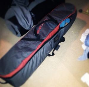 This is me packed into my partner's snowboard bag. I am pretty good at procrastinating.
